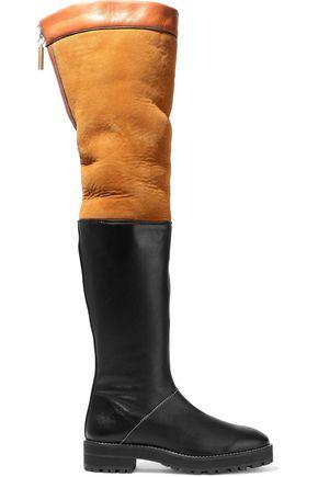 STUART WEITZMAN حذاء بعنق طويل فوق الركبة من الجلد ومن صوف الحمل بلونين