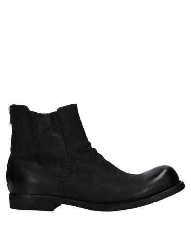 Фото - Полусапоги и высокие ботинки от OFFICINE CREATIVE ITALIA черного цвета