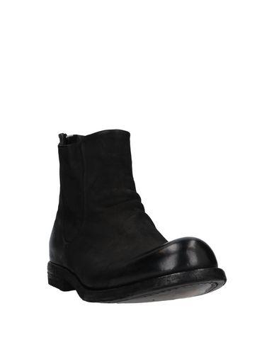 Фото 2 - Полусапоги и высокие ботинки от OFFICINE CREATIVE ITALIA черного цвета