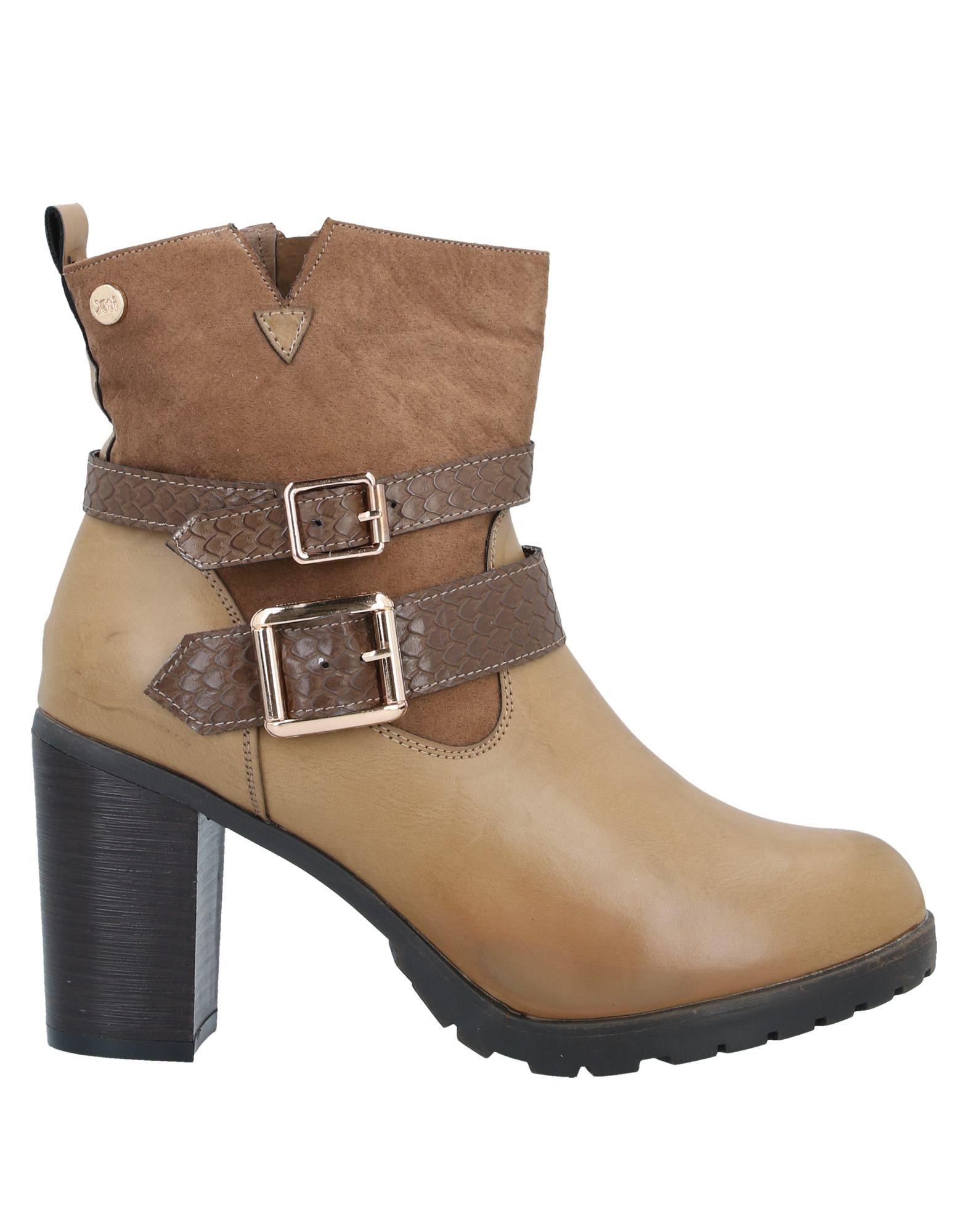 купить XTI Полусапоги и высокие ботинки дешево