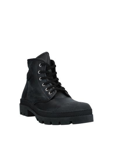 Фото 2 - Полусапоги и высокие ботинки от VERSUS VERSACE черного цвета