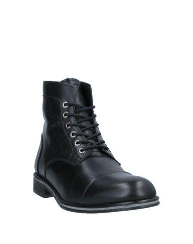 Фото 2 - Полусапоги и высокие ботинки от BOTTEGA MARCHIGIANA черного цвета