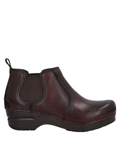 Фото - Полусапоги и высокие ботинки от DANSKO темно-коричневого цвета