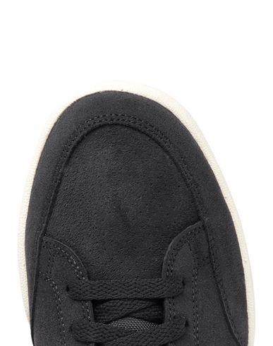 Фото 2 - Низкие кеды и кроссовки черного цвета