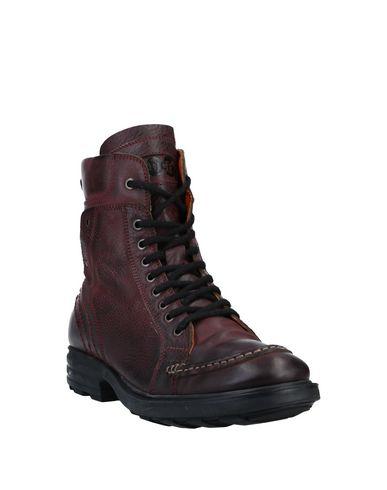 Фото 2 - Полусапоги и высокие ботинки от POLICE 883 красно-коричневого цвета