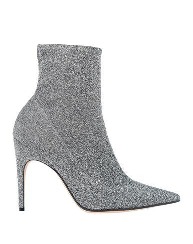 Фото - Полусапоги и высокие ботинки серебристого цвета