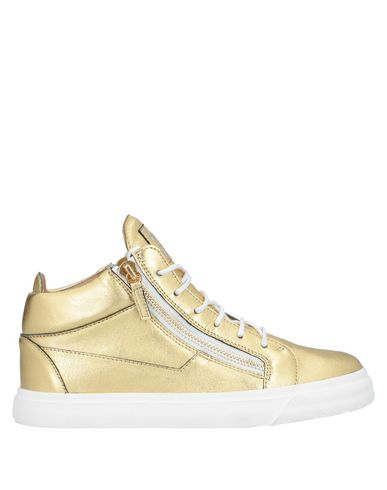 Фото - Высокие кеды и кроссовки золотистого цвета