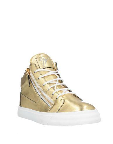 Фото 2 - Высокие кеды и кроссовки золотистого цвета