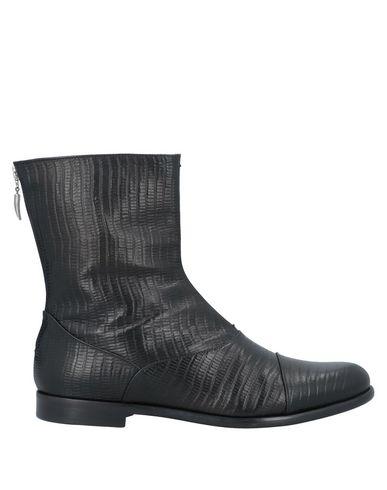 Фото - Полусапоги и высокие ботинки от UNCONVENTIONAL ROYAL черного цвета