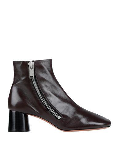 Полусапоги и высокие ботинки Celine