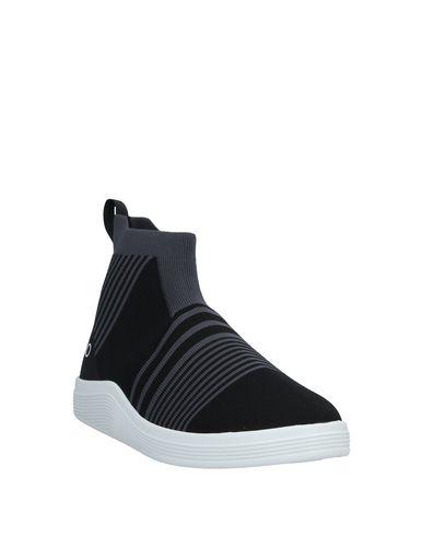 Фото 2 - Высокие кеды и кроссовки от ADNO® черного цвета