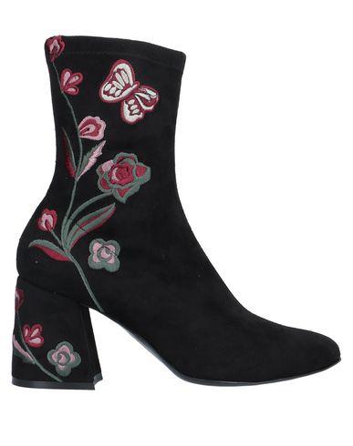 Купить Полусапоги и высокие ботинки от JEANNOT черного цвета