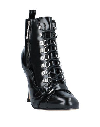 Фото 2 - Полусапоги и высокие ботинки от TWINSET черного цвета