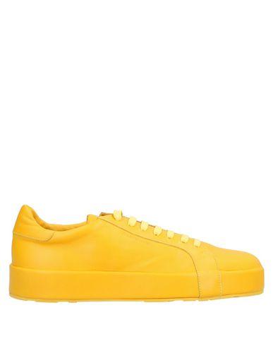Фото - Низкие кеды и кроссовки желтого цвета