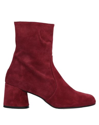 Фото - Полусапоги и высокие ботинки от UNLACE красного цвета