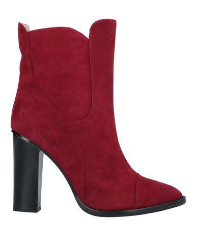Фото - Полусапоги и высокие ботинки красного цвета