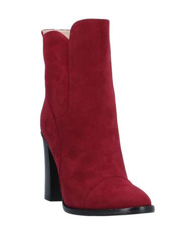 Фото 2 - Полусапоги и высокие ботинки красного цвета