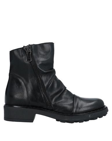 Фото - Полусапоги и высокие ботинки от UNLACE черного цвета