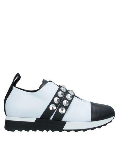 Купить Низкие кеды и кроссовки от JEANNOT белого цвета