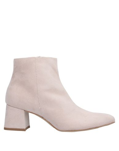 Купить Полусапоги и высокие ботинки от DIVINE FOLLIE светло-розового цвета