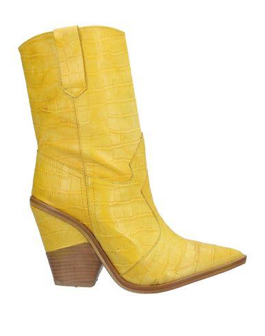 Купить Полусапоги и высокие ботинки от DIVINE FOLLIE желтого цвета