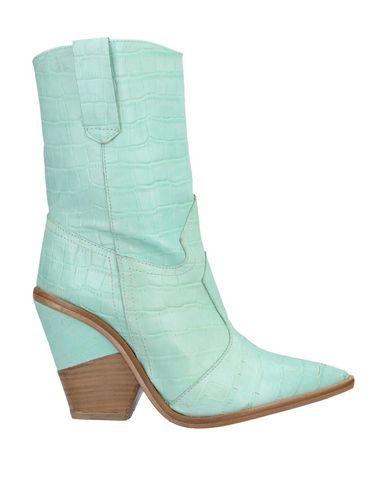 Купить Полусапоги и высокие ботинки от DIVINE FOLLIE светло-зеленого цвета