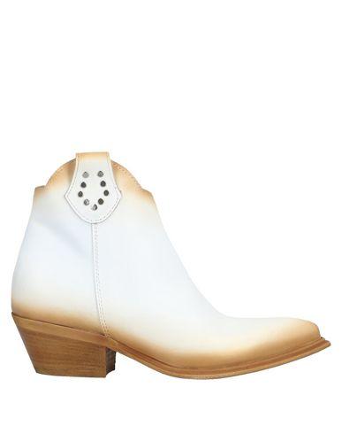 Купить Полусапоги и высокие ботинки от DIVINE FOLLIE белого цвета