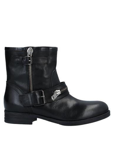 Купить Полусапоги и высокие ботинки от ELIANA BUCCI черного цвета