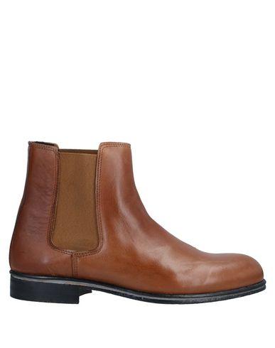 Фото - Полусапоги и высокие ботинки от BOTTEGA MARCHIGIANA желто-коричневого цвета