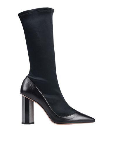 Купить Полусапоги и высокие ботинки от G.P. PER NOY BOLOGNA черного цвета