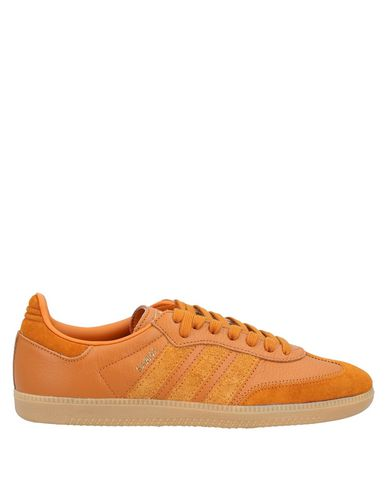 Купить Низкие кеды и кроссовки желто-коричневого цвета