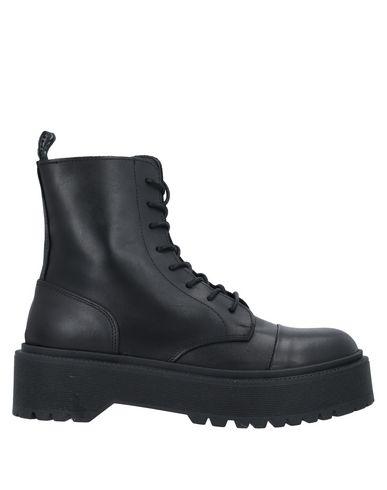 Купить Полусапоги и высокие ботинки от UNLACE черного цвета