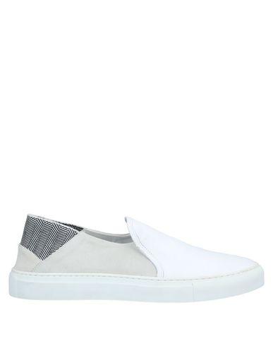 Купить Низкие кеды и кроссовки от YLATI белого цвета