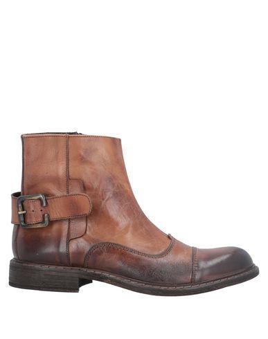 Купить Полусапоги и высокие ботинки от SANGUE коричневого цвета