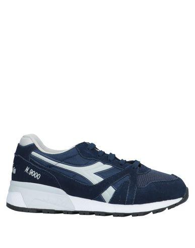Купить Низкие кеды и кроссовки темно-синего цвета