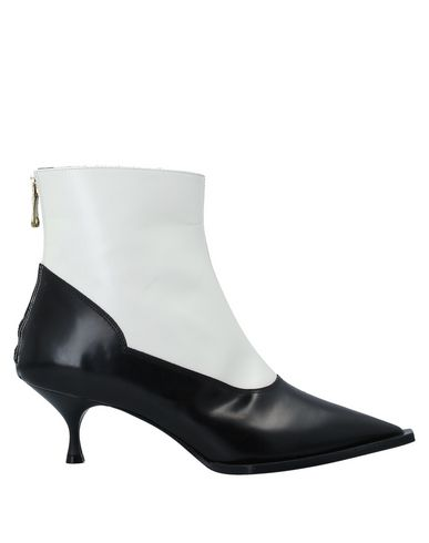 Фото - Полусапоги и высокие ботинки от TIPE E TACCHI черного цвета