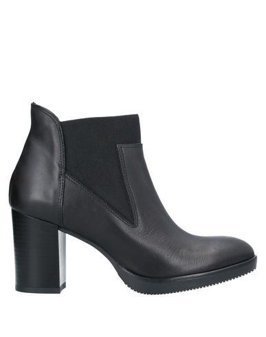 Купить Полусапоги и высокие ботинки от TSD12 черного цвета
