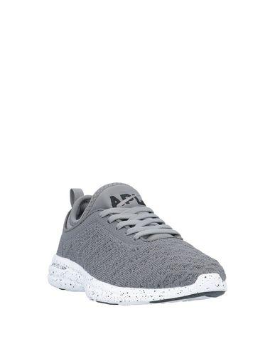 Фото 2 - Низкие кеды и кроссовки от APL® ATHLETIC PROPULSION LABS серого цвета