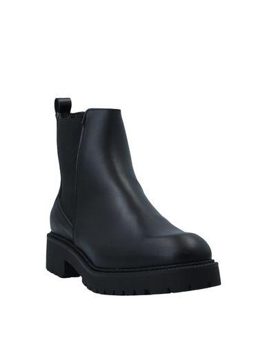 Фото 2 - Полусапоги и высокие ботинки от FLAVIO CREATION черного цвета