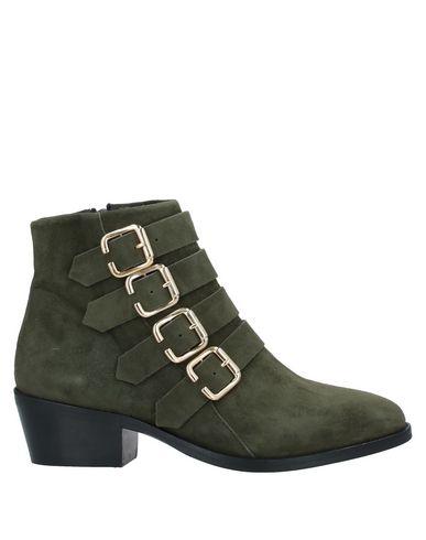 Фото - Полусапоги и высокие ботинки от ANAKI зеленого цвета
