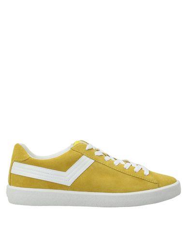 Купить Низкие кеды и кроссовки желтого цвета
