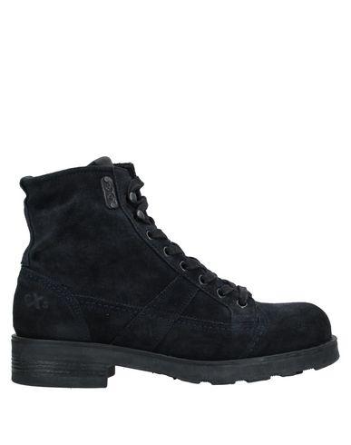 Купить Полусапоги и высокие ботинки от O.X.S. темно-синего цвета