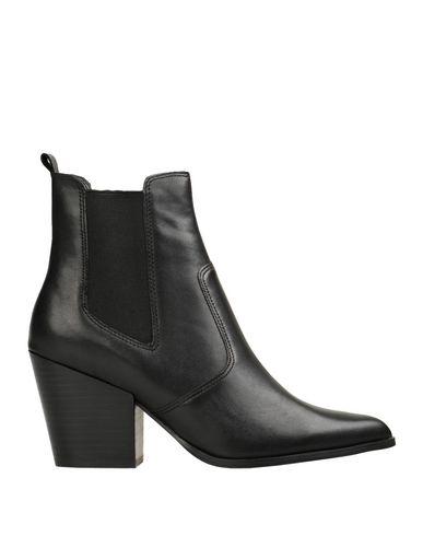Купить Полусапоги и высокие ботинки от STEVE MADDEN черного цвета