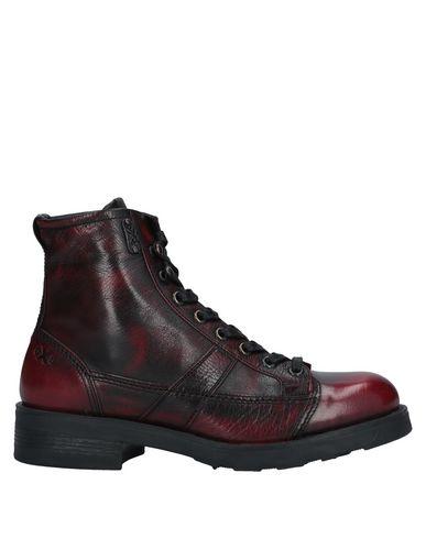 Купить Полусапоги и высокие ботинки от O.X.S. красного цвета