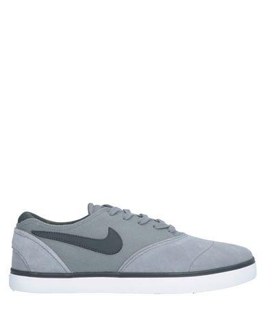 Купить Низкие кеды и кроссовки от NIKE SB COLLECTION серого цвета