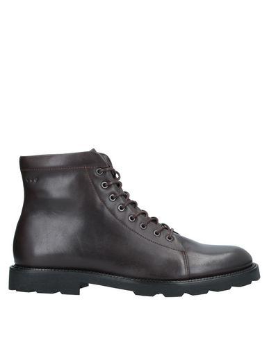 Купить Полусапоги и высокие ботинки от ROYAL REPUBLIQ темно-коричневого цвета