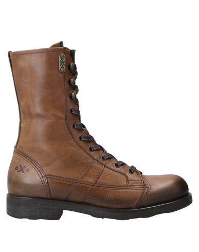 Купить Полусапоги и высокие ботинки от O.X.S. коричневого цвета