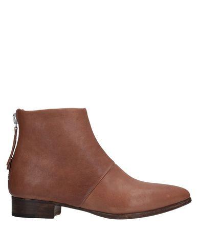 Купить Полусапоги и высокие ботинки желто-коричневого цвета