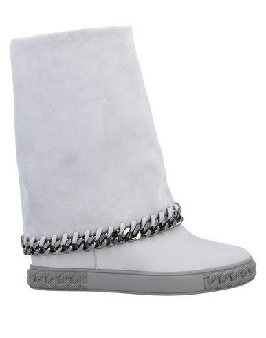Полусапоги и высокие ботинки Casadei