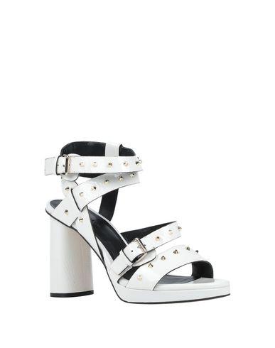 Фото 2 - Женские сандали ELVIO ZANON белого цвета